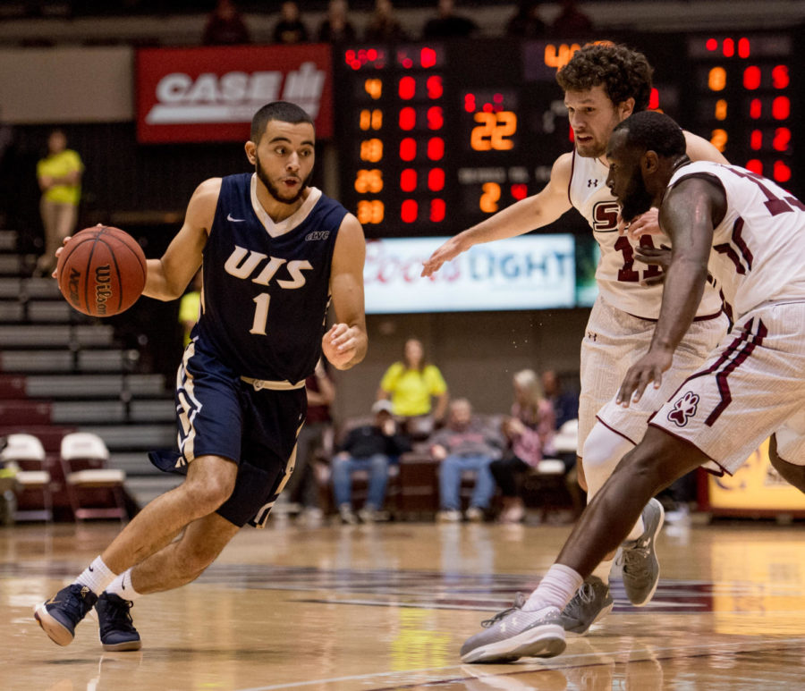 University of Illinois Springfield's Lijah Donnelly, left, advances the ball past SIU's Tyler Smithpeters, 11, and Sean Lloyd Jr., Saturday, Nov. 18, 2017, during the Salukis' 69-64 win against the University of Illinois Springfield Prairie Stars at SIU Arena. (Brian Muñoz | @BrianMMunoz)