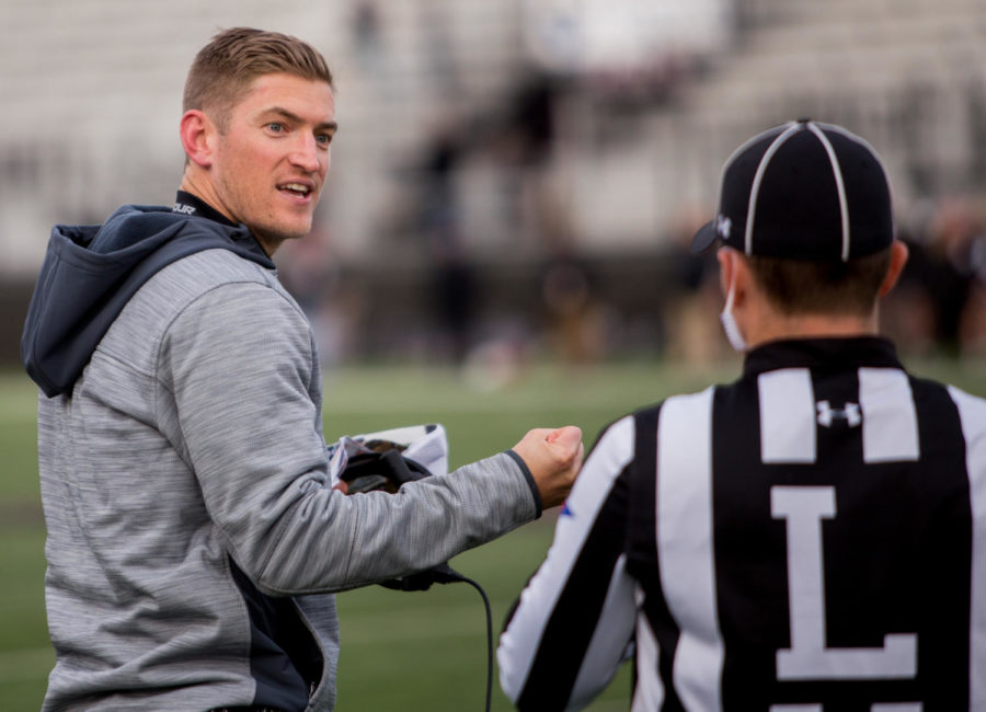 Football head coach Nick Hill speaks with a referee Saturday, Nov. 11, 2017, during the Salukis' 28-20 loss against the Youngstown State Penguins at Saluki Stadium. (Brian Muñoz | @BrianMMunoz)