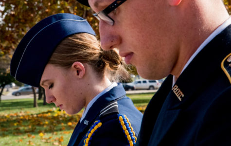 "Air Force ROTC cadet Lexie Layton, left, and Army ROTC Cadet Devin Tegtman stand at a modified parade rest in front of the flagpole Friday, Nov. 10, 2017, outside of Woody Hall. ""I'm out there to celebrate the veterans of America and make sure people know it's Veterans Day,"
