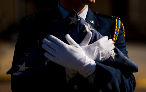 Air Force ROTC cadet Matthew Merdian, a senior aviation management, holds the American flag Friday, Nov. 10, 2017, during the annual Veteran's Day ceremony at Veterans Memorial Plaza. (Brian Muñoz | @BrianMMunoz)