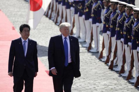 U.S. President Donald Trump, center, and Shinzo Abe, Japan's prime minister, walk past an honor guard at Akasaka Palace in Tokyo, Japan, on Monday, Nov. 6, 2017. (Kiyoshi Ota/Bloomberg (Kiyoshi Ota/Xinhua/ZUMA Wire/TNS)