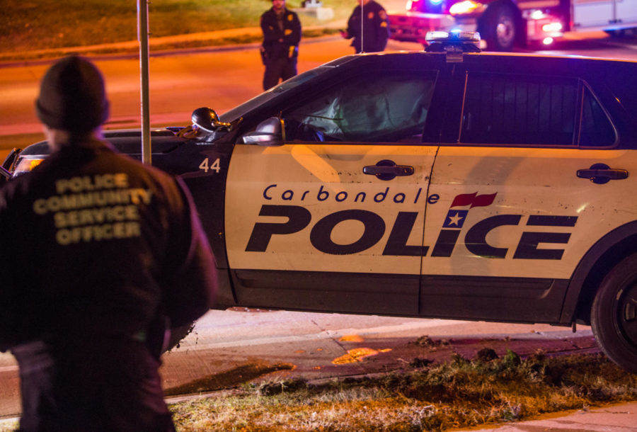 A Carbondale police vehicle is pulled off of a sidewalk after colliding with another vehicle  Monday, Nov. 20, 2017, at the intersection of Illinois Avenue and Mill Street in Carbondale. (Brian Muñoz | @BrianMMunoz)