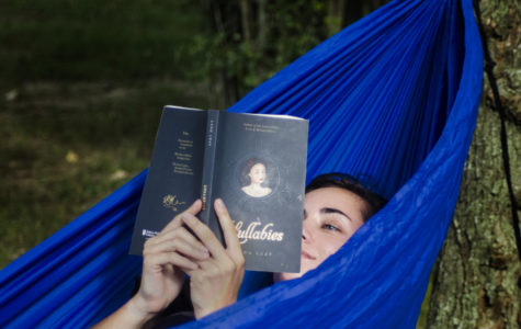 "Tayler Goldtrap, a junior forestry major from Kankakee, reads a poetry book while relaxing in a hammock on Aug. 22, 2017, at Thompson Point, in Carbondale. ""I chose this spot because it was near my dorm building and the trees were positioned perfectly to connect my [hammock] attachments,"" Goldtrap said. ""I was reading the book 'Lullabies' by Lang Leav because I was looking for inspiration to write again."" (Dylan Nelson 