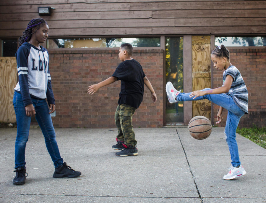 Nicyah Hastings-Atkins, 9, right, plays with a basketball as Malachi Suggs, 10, center practices his moves and A'Niyah Black, 13, watches outside of the Eurma C. Hayes Center on Wednesday, Aug. 23, 2017, in Carbondale.