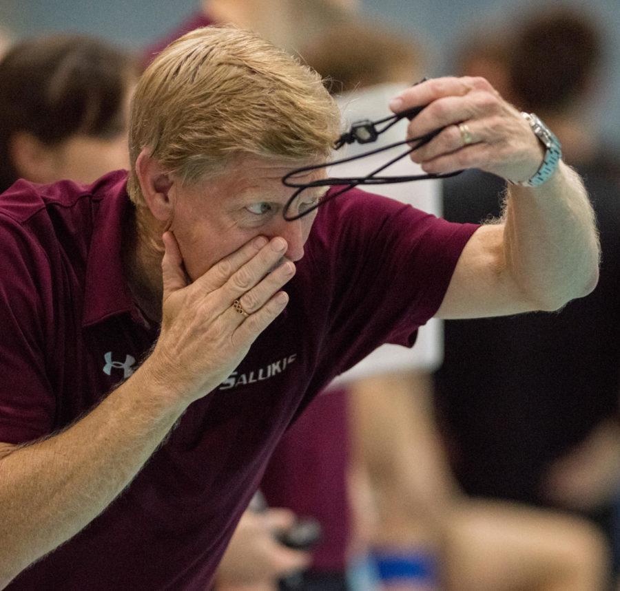 SIU swim coach Richard Walker cheers on members of the SIU swim team Saturday, Nov. 4, 2017, in the Dr. Edward Shea Natatorium. (Brian Mu–noz | @BrianMMunoz)