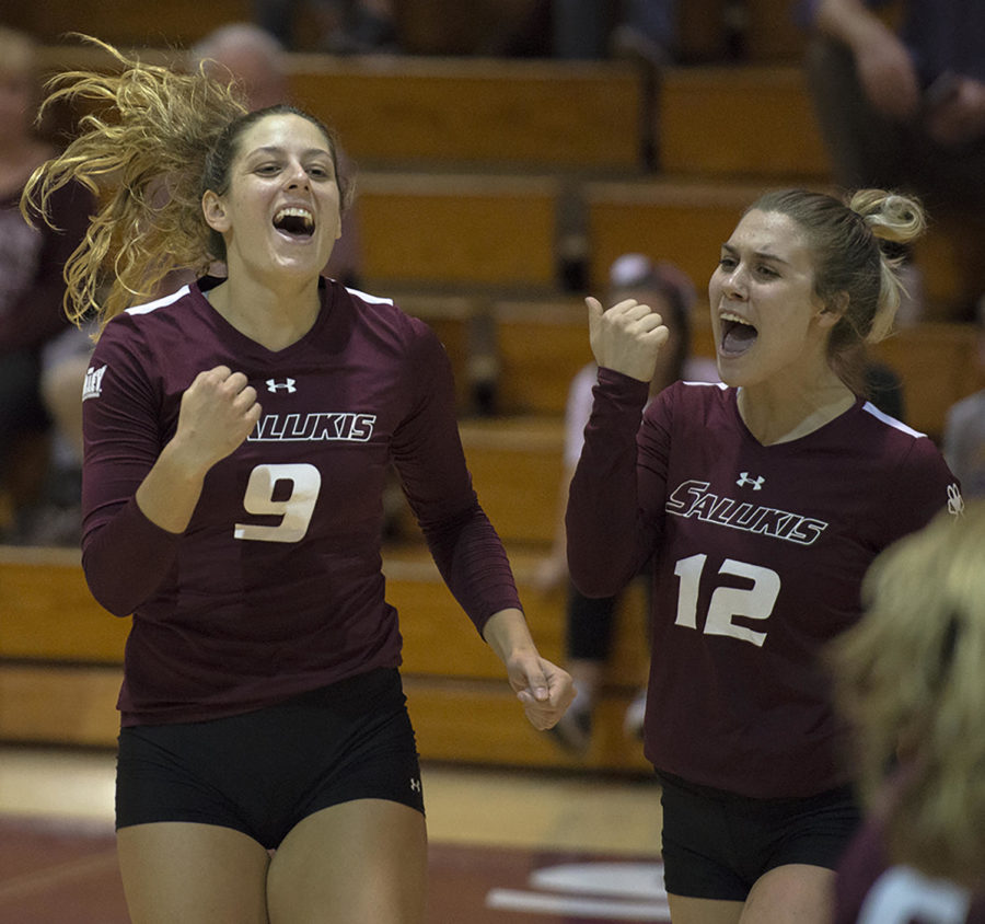 Senior outside hitter Andrea Estrada, left, and sophomore outside hitter Alyssa Sutton celebrate point, Saturday, Oct. 20, 2017, during the SalukisÕ 3-2 loss against the Bradley University Braves, at Davies Gym. (Mary Newman | @MaryNewmanDE)