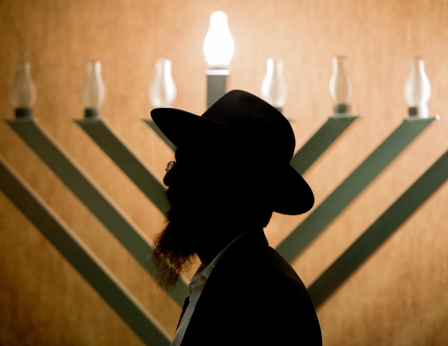 Rabbi Mendel Scheiman delivers remarks after lighting an electric menorah on the first day of Hanukkah Tuesday, Dec. 12, 2017, at the Old Main Lounge in SIU's Student Center. (Brian Muñoz | @BrianMMunoz)