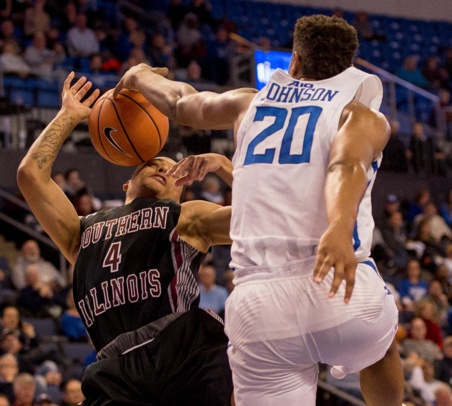 Saint Louis University sophomore forward Jalen Johnson, right, attempts to steal the ball from junior guard Eric McGill Wednesday, Dec. 6, 2017, during the Salukis' 69-74 loss against the Billikens at Chaifetz Arena in St. Louis, Missouri. (Brian Muñoz | @BrianMMunoz)