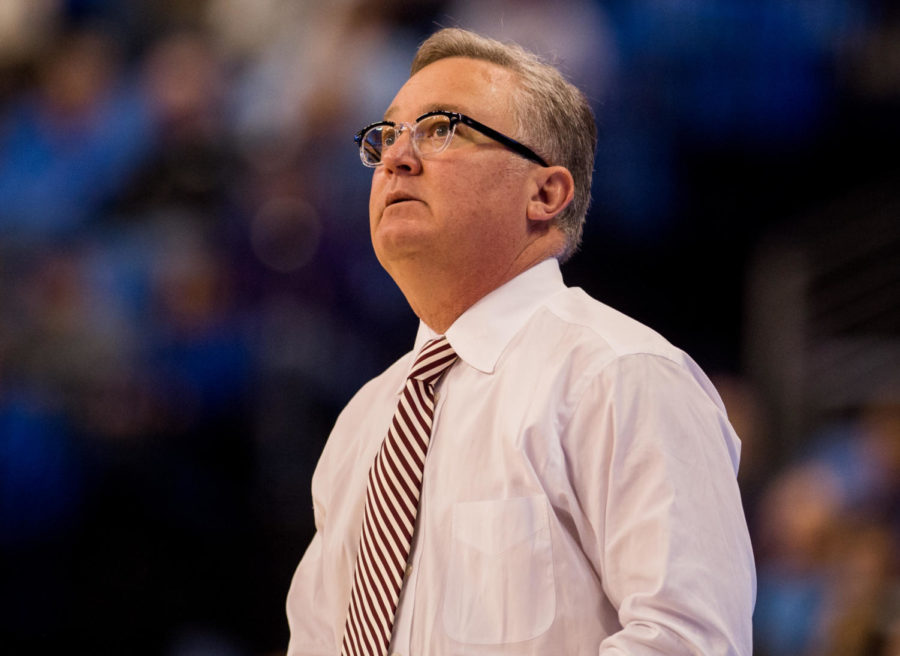 SIU head men's basketball coach Barry Hinson watches an instant replay Wednesday, Dec. 6, 2017, during the Salukis' 69-74 loss against the St. Louis University Billikens at Chaifetz Arena in St. Louis, Missouri. (Brian Muñoz | @BrianMMunoz)
