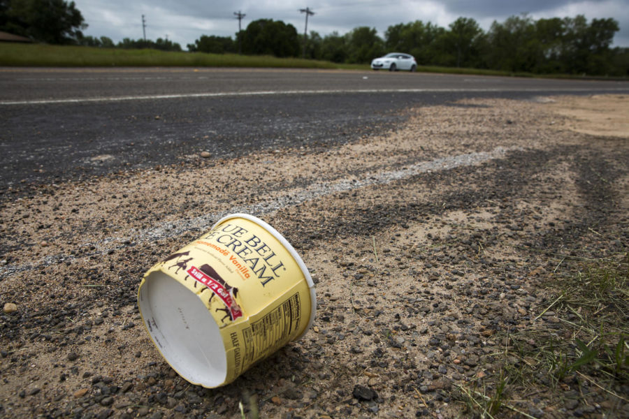 A container for Blue Bell homemade vanilla ice cream litters the side of Texas State Highway 105  on Thursday, April 23, 2015, in Brenham, Texas. Blue Bell recalled all of its products earlier in the week after more ice cream samples tested positive for Listeria. (Smiley N. Pool/Dallas Morning News/TNS)