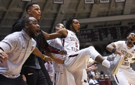 SIU senior forward John Gardner jumps in the air after the Salukis score a basketball during SIU's 82-77 win against Indiana State on Wednesday, Jan. 24, 2018, at SIU Arena.