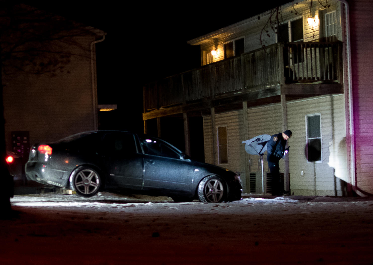 A black Audi sedan is towed from the Park Avenue apartment complex Wednesday, Jan. 18, 2018, after crashing into the building off of East Park Street. (Brian Muñoz | @BrianMMunoz)