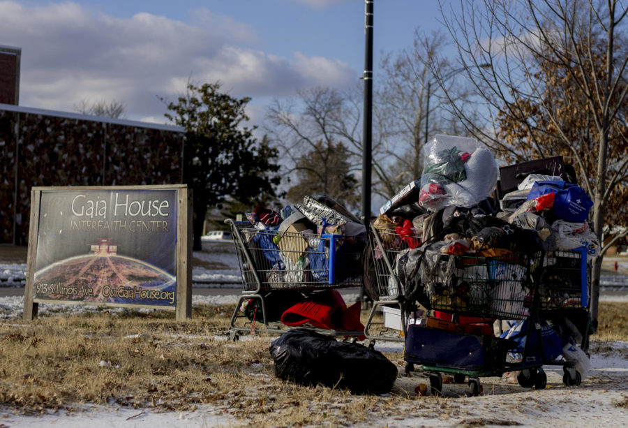 Shopping carts filled with personal belongings Saturday, Jan. 13, 2018, outside the Gaia House Interfaith Center in Carbondale. Gaia House is serving as an emergency warming station for the homeless this winter. (Mary Newman | @MaryNewmanDE)​