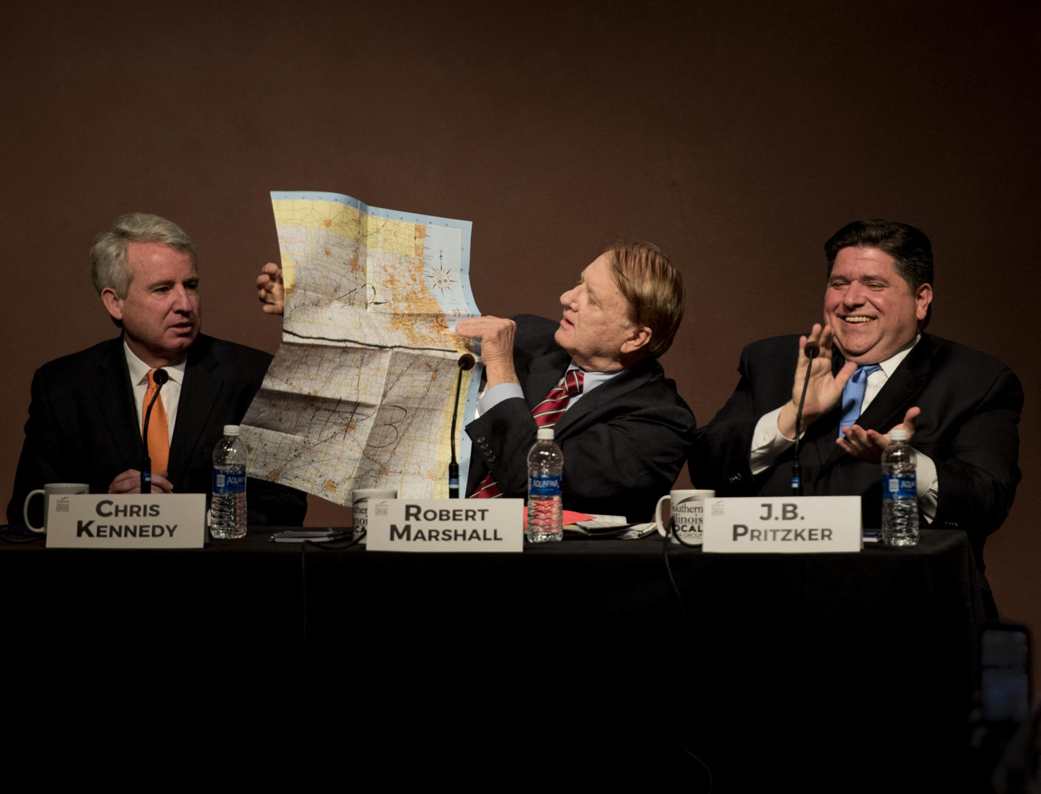 Robert Marshall, democratic candidate for the State of Illinois gubernatorial race, holds up a map Tuesday, Jan. 30, 2018, after interupting candidate Chris Kennedy at the Illinois Demoratic gubernatorial debate in the student center auditorium. 6 candidates from across Illinois are vying for the governor's seat. (Mary Newman | @MaryNewmanDE)
