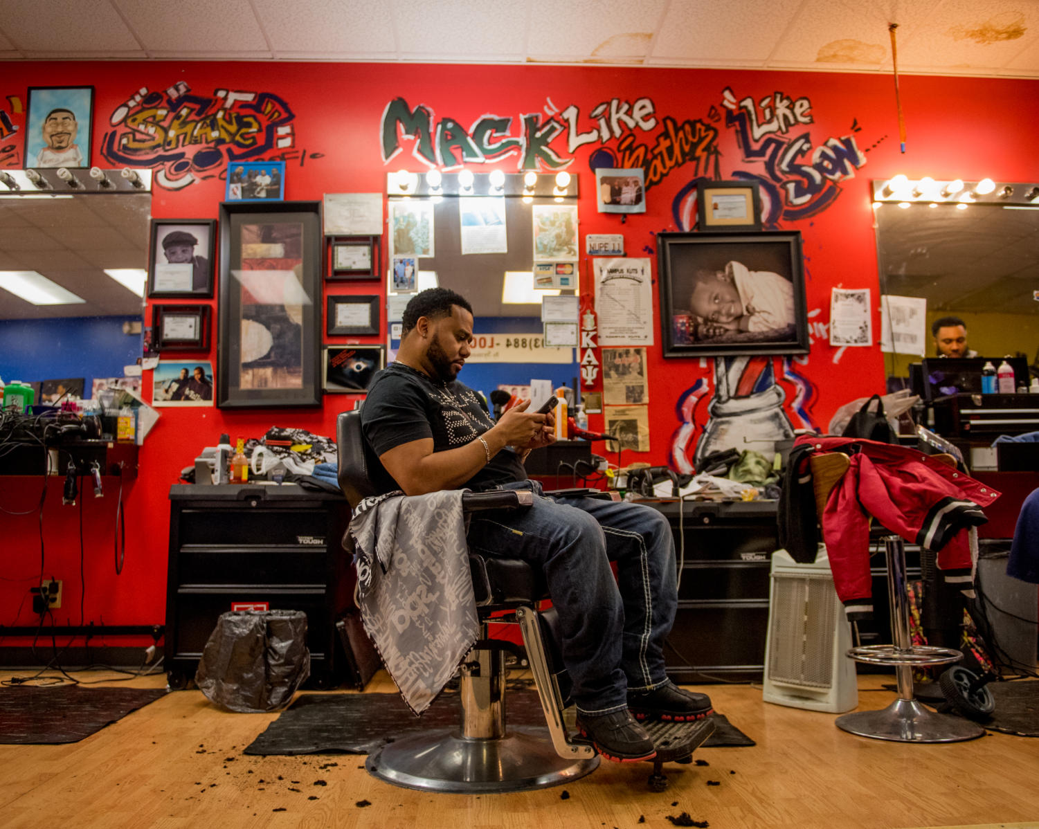 Moshe Anderson, Kampus Kuts shop owner/ waits for customers Monday, Jan. 30, 2018, at Kampus Kuts in Carbondale.