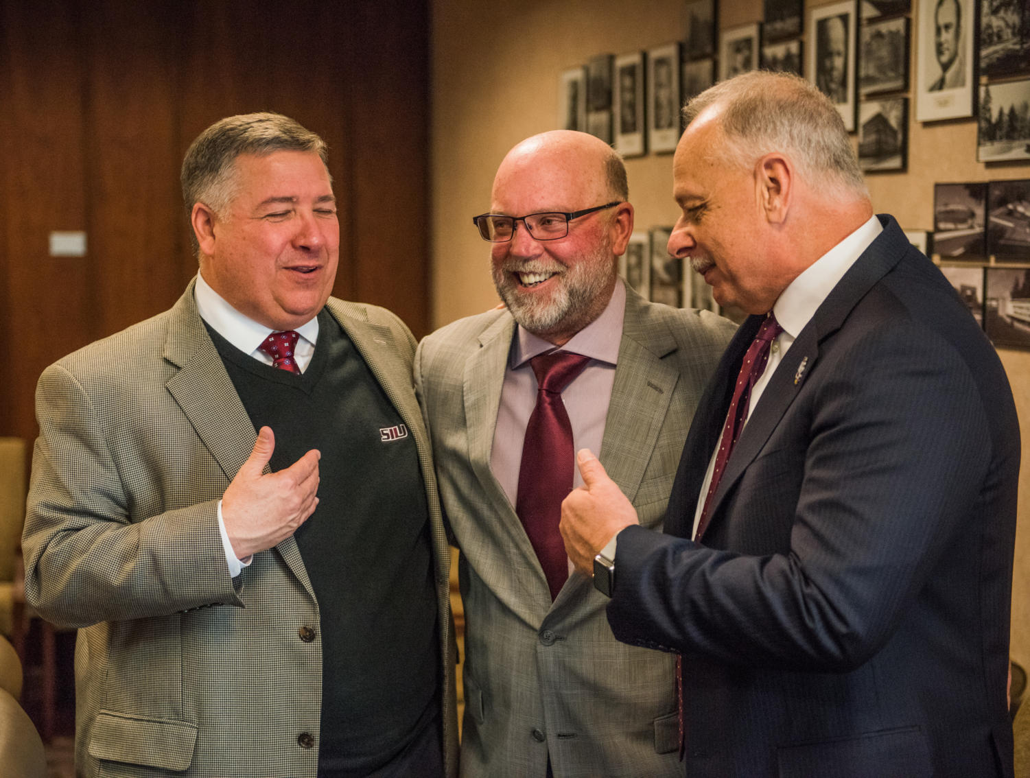 From left: Tommy Bell, SIU Director of Athletics, Jerry Kill, special assistant to the chancellor, and Carlo Montemagno, SIU Chancellor chat Tuesday, January. 30, 2018, after the public announcement of Kill's appointment to serve as an ambassador and fundraiser for the university in Anthony Hall. (Brian Munoz | @BrianMMunoz)
