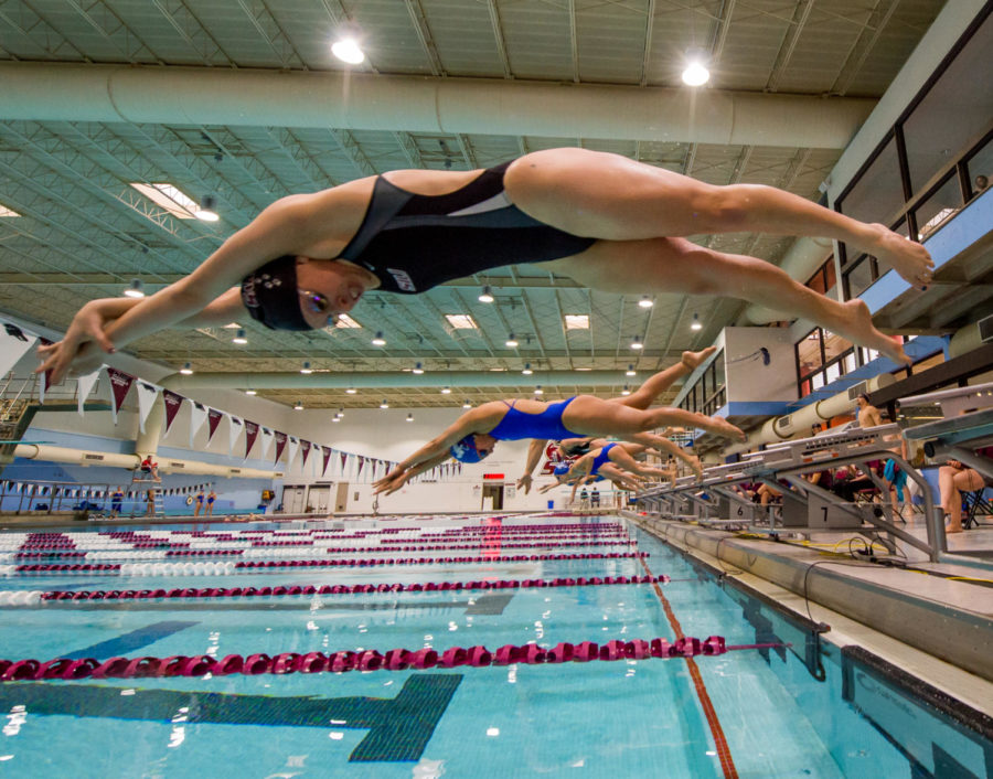 Salukis senior Penny Browser launches off the block during the Womens 50 Yard Freestyle Saturday, Jan. 27, 2018, during the Salukis meet against the Indiana State Sycamores at the Edward J. Shea Natatorium in the recreation center. (Brian Munoz | @BrianMMunoz)