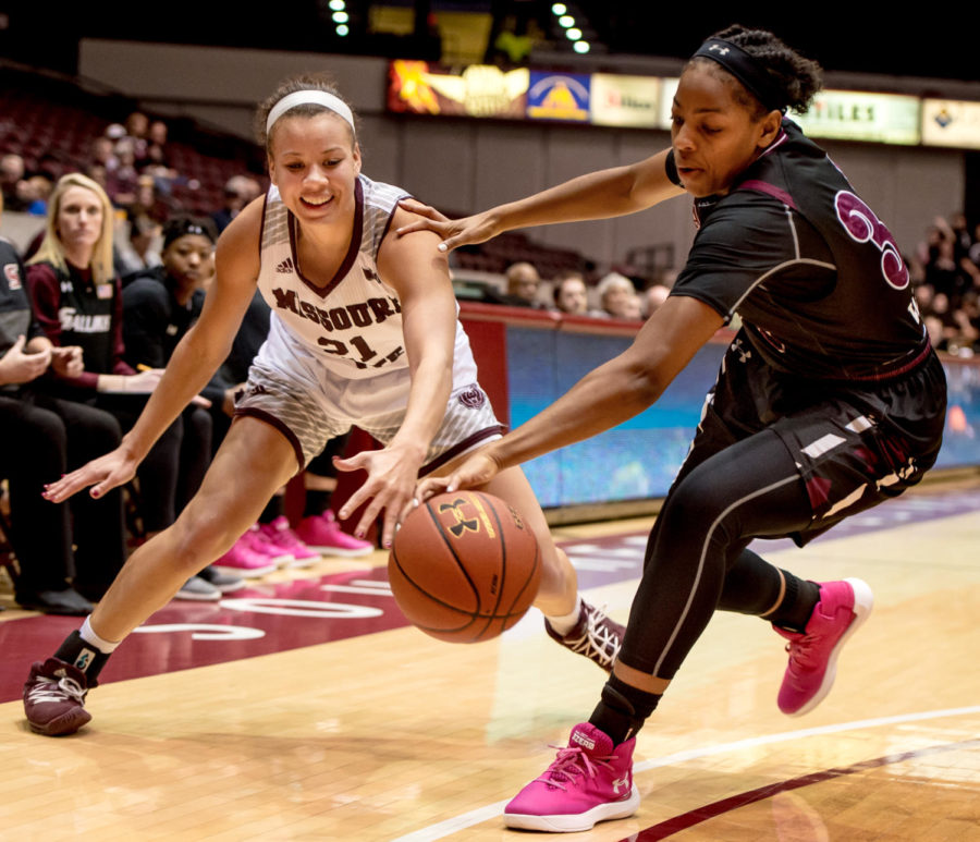 Sophomore forward Nicole Martin fights Missouri State forward Aubrey Buckley for the ball Friday, Jan. 26, 2018, during the Salukis' 71-69 win over the Missouri State University Bears at SIU Arena.