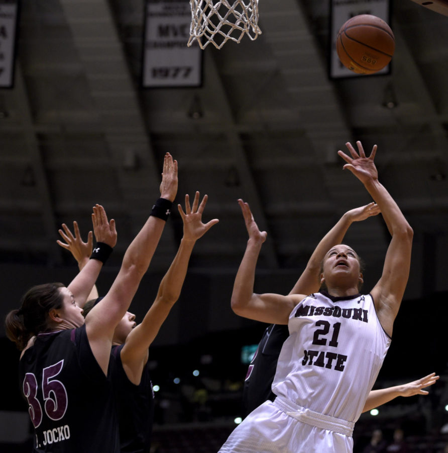 Missouri State forward Aubrey Buckley, right, jumps for the ball while under SIU pressure Friday, Jan. 26, 2018, during the Salukis' 71-69 win over the Missouri State University Bears at SIU Arena. (Reagan Gavin | @RGavin_DE)
