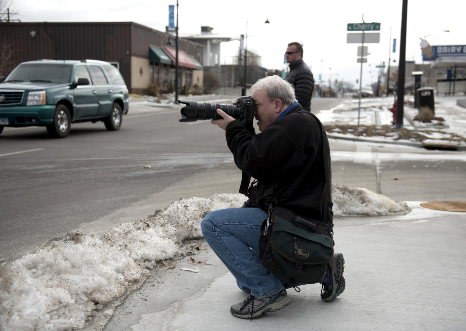 Photojournalist Richard Sitler photographs demonstrators Saturday, Jan. 20, 2018, during the Southern Illinois March to the Polls in Carbondale. (Dylan Nelson | @Dylan_Nelson99)