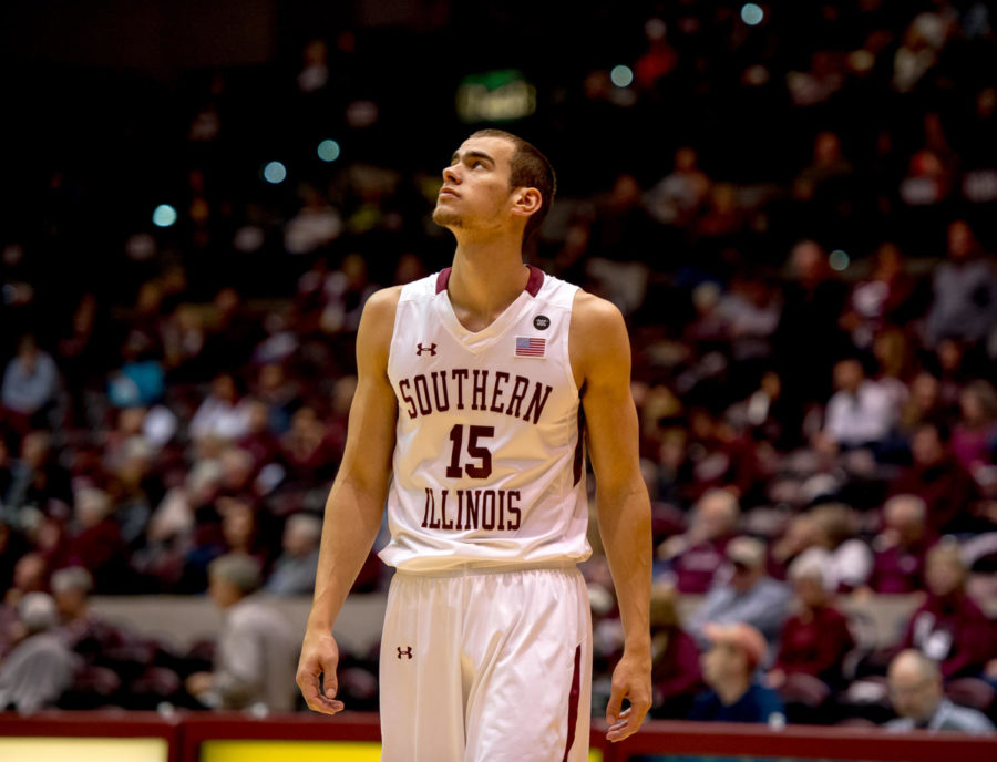 Junior forward Austin Weiher looks to the scoreboard Sunday, Jan. 21, 2018, during the Salukis' 64-53 victory over the University of Northern Iowa Panthers at SIU Arena. (Brian Munoz | @BrianMMunoz)