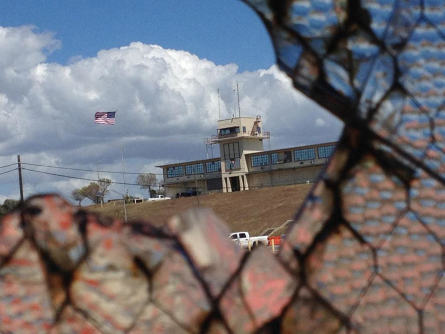 The war court headquarters at Camp Justice, as seen through a broken window at an obsolete air hangar at the U.S. Navy base at Guantanamo Bay, Cuba, on February 28, 2015, in an image approved for release by the U.S. military. (Carol Rosenberg/Miami Herald/TNS)