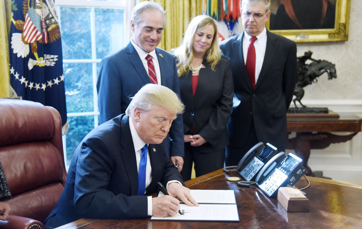U.S President Donald Trump signs an Executive Order on