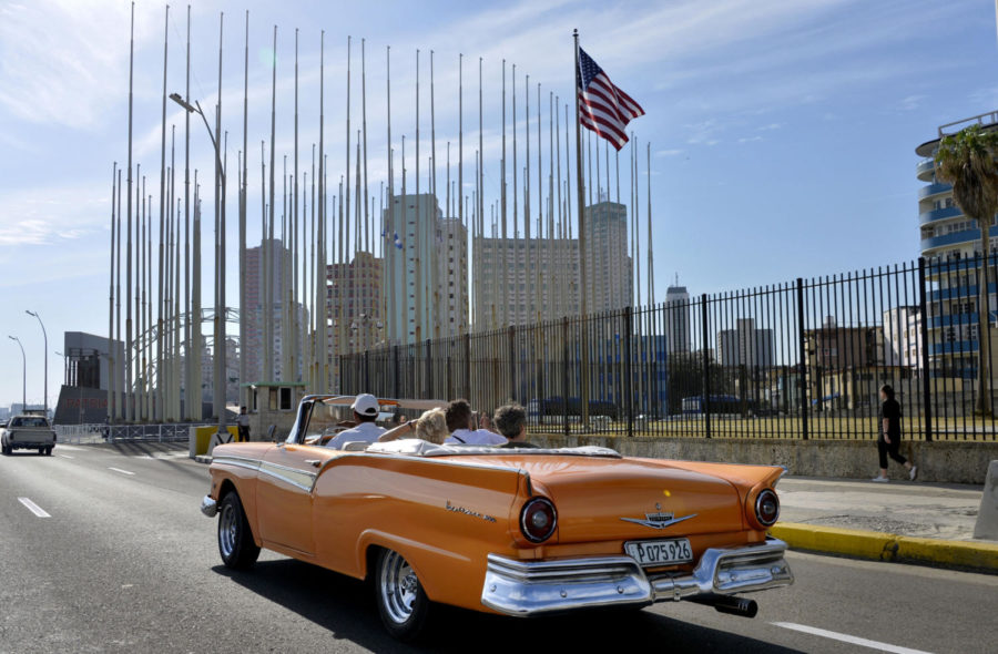 An+old+car+passes+in+front+of+the+U.S+Embassy+in+Havana%2C+Cuba%2C+on+March+17%2C+2016%2C+prior+to+a+visit+by+U.S.+President+Barack+Obama.+%28Olivier+Douliery%2FAbaca+Press%2FTNS%29