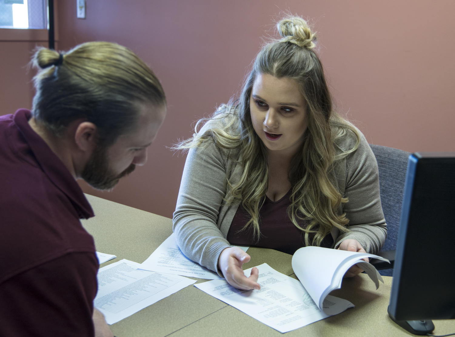 From left: Michael Justin Miller, 26, of Louisville, Kentucky,and Allysha Kochrnour, 25, of Millersburg Pennsylvania, review surveys Friday, Feb. 2, 2018, at DxR Development Group Inc. in the SIU Research Park. Both Miller and Kochenour are graduate students in Applied Psychology involved in the Applied Research Consultants firm at SIU. (Mary Newman | @MaryNewmanDE)