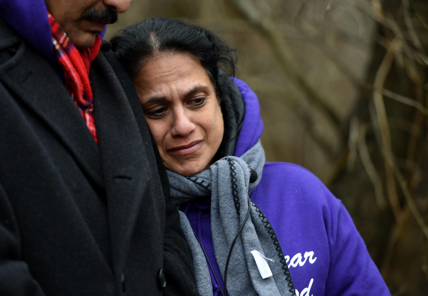 Lovely Varughese, mother of Pravin Varughese, morns the death of her son, Friday, Feb. 16, 2018, in the woods near East Main Street and Giant City Road where her son was found dead in 2014. (Mary Newman | @MaryNewmanDE)