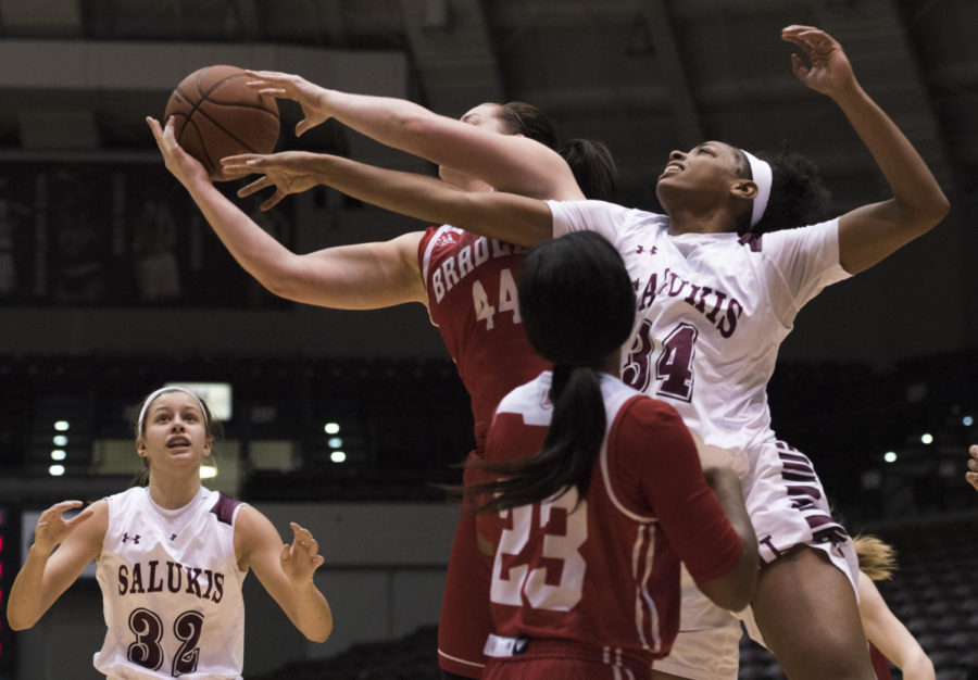 Sophomore forward/center Nicole Martin reaches to block the ball from Braves' Junior forward Vanessa Markert (44) during a match-up against the Bradley University Braves, the Salukis lead by 9 for a final score of 62-53 on Sunday, Feb. 11, 2018 at The SIU Arena. (Dylan Nelson | @Dylan_Nelson99)