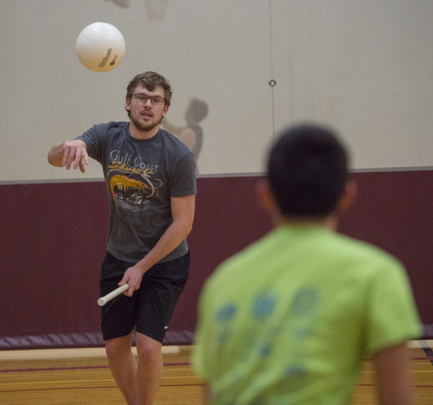 Junior Mechanical Engineering major Matthew Lunde, 20, passes the ball to his teammateMonday, Jan. 29, 2018 during quidditch practice at the student recreation center in Carbondale. (Dylan Nelson | @Dylan_Nelson99)