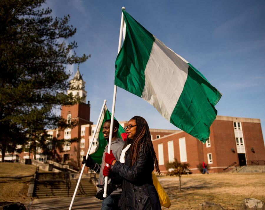 Abimbola+Iyun%2C+a+doctorate+candidate+in+the+College+of+Mass+Communications+and+Media+Arts+from+Nigeria%2C+marches+across+campus+while+holding+the+Nigerian+flag+Monday%2C+Feb.+5%2C+2018%2C+during+the+International+Parade+of+Flags+outside+of+Pulliam+Hall.+%28Brian+Munoz+%7C+%40BrianMMunoz%29
