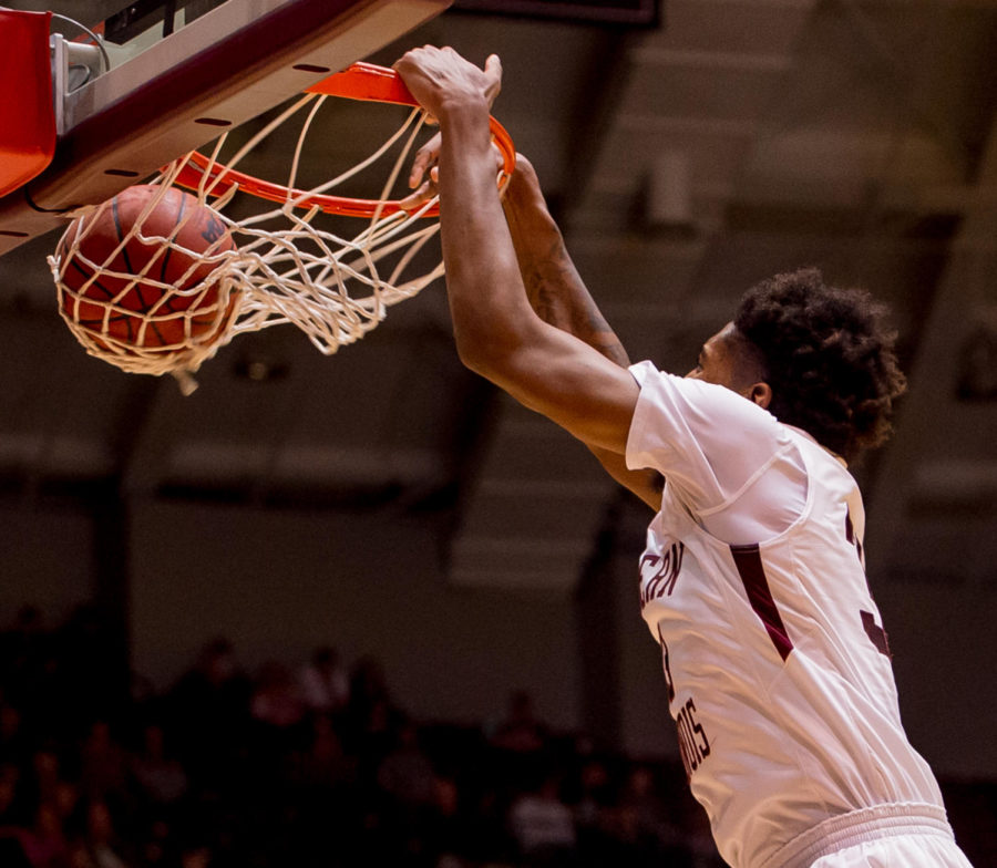 Junior center Kavion Pippen slam dunks the ball Wednesday, Feb. 14, 2018, during the Salukis' 81-80 win against the Missouri State Bears at SIU Arena. (Brian Munoz | @BrianMMunoz)