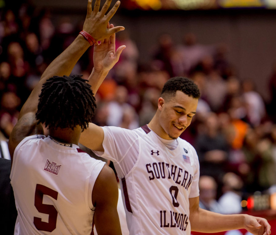 Senior forward Jonathan Wiley high fives senior forward John Gardner Wednesday, Feb. 14, 2018, during the Salukis' 81-80 win against the Missouri State Bears at SIU Arena. (Brian Munoz | @BrianMMunoz)