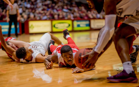 Bradley University forward Elijah Childs watches as Southern's Sean Lloyd Jr. picks up the ball after a scuffle with Southern's Aaron Cook on Sunday, Feb. 11, 2018, during the Salukis' 74-57 win against the Bradley Braves at SIU Arena. The Salukis are now the lone second place team in the Missouri Valley Conference.