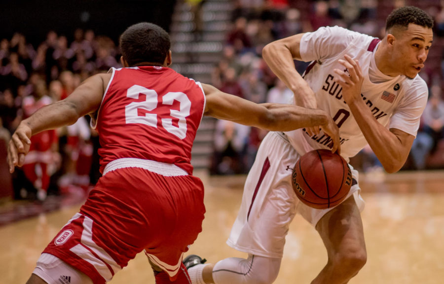 Senior forward Jonathan Wiley attempts to pass the ball past Bradley guard Dwayne Lautier-Ogunleye Sunday, Feb. 11, 2018, during the Salukis' 74-57 win against the Bradley Braves at SIU Arena. The Salukis are now the lone second place team in the Missouri Valley Conference. (Brian Munoz | @BrianMMunoz)