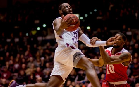 Bradley forward Elijah Childs, right, holds down Junior guard Sean Lloyd Jr. as he attempts to go for a basket Sunday, Feb. 11, 2018, during the Salukis' 74-57 win against the Bradley Braves at SIU Arena. The Salukis are now the lone second place team in the Missouri Valley Conference. (Brian Munoz | @BrianMMunoz)