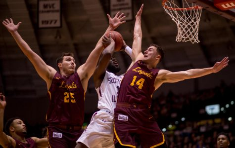 Junior guard Sean Lloyd Jr. goes for a basket Loyola center Cameron Krutwig and guard Ben Richardson Wednesday, Feb. 21, 2018, during the Loyola Rambler's 75-68 victory against the Southern Illinois University Salukis at SIU Arena. (Brian Munoz | @BrianMMunoz)
