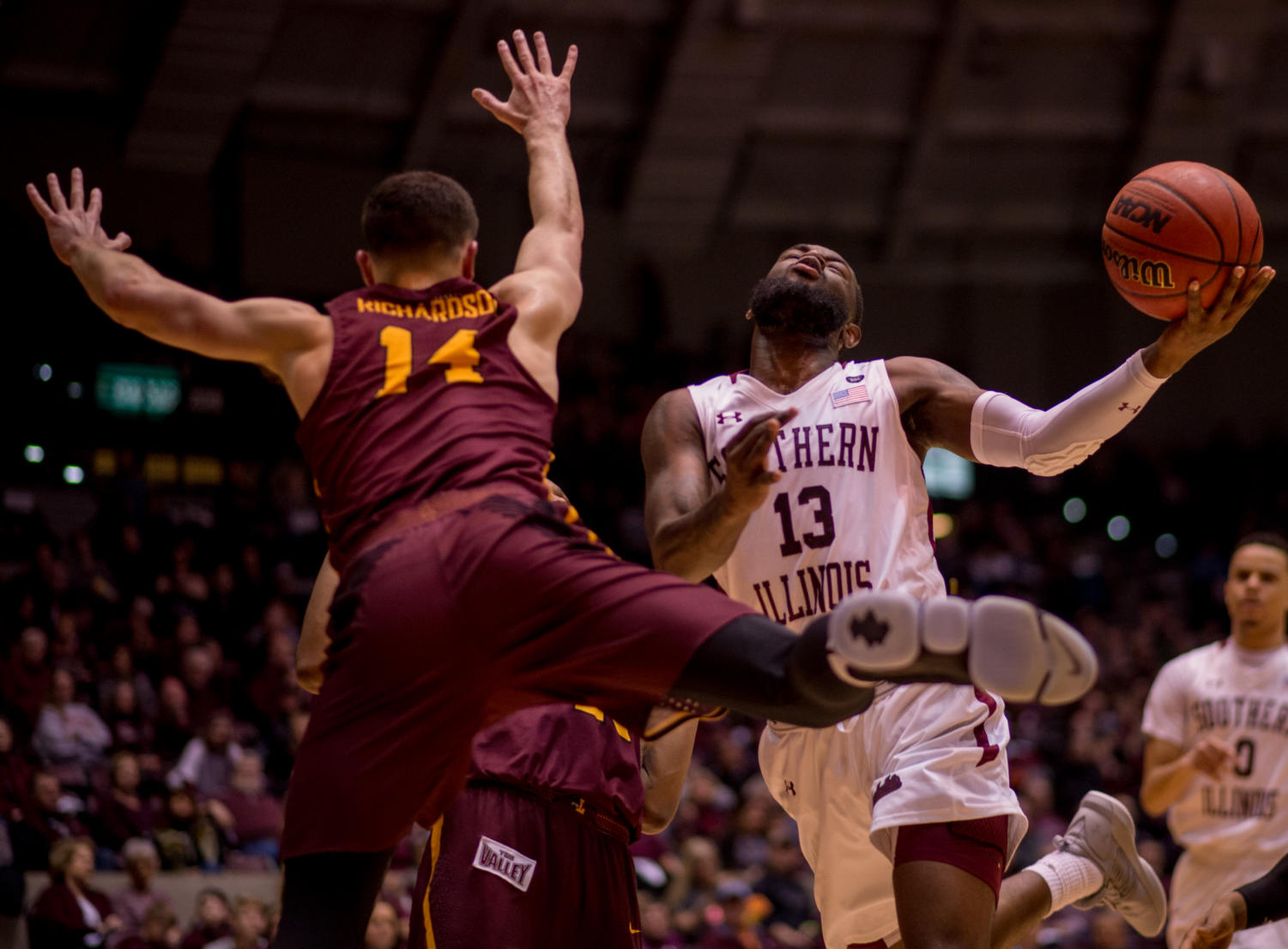Junior guard Sean Lloyd Jr. keeps the ball from Loyola guard Ben Richardson Wednesday, Feb. 21, 2018, during the Loyola Rambler's 75-68 victory against the Southern Illinois University Salukis at SIU Arena. (Brian Munoz | @BrianMMunoz)