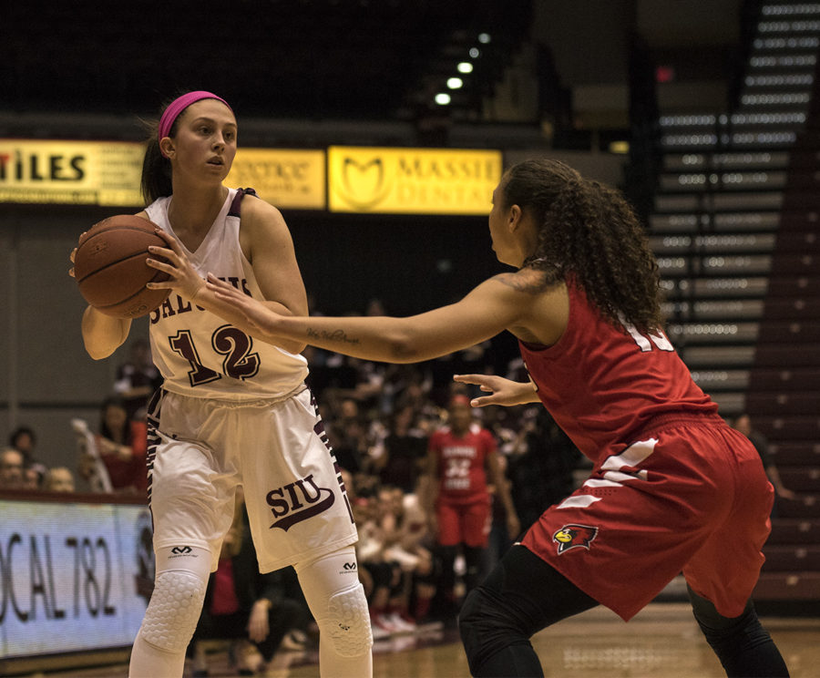 Freshman guard Mackenzie Silvey looks to pass the ball Friday, Feb. 9, 2018, duing the Salukis' 39-36 loss to the Illlinois State University Redbirds at SIU Arena. (Reagan Gavin | @RGavin_DE)