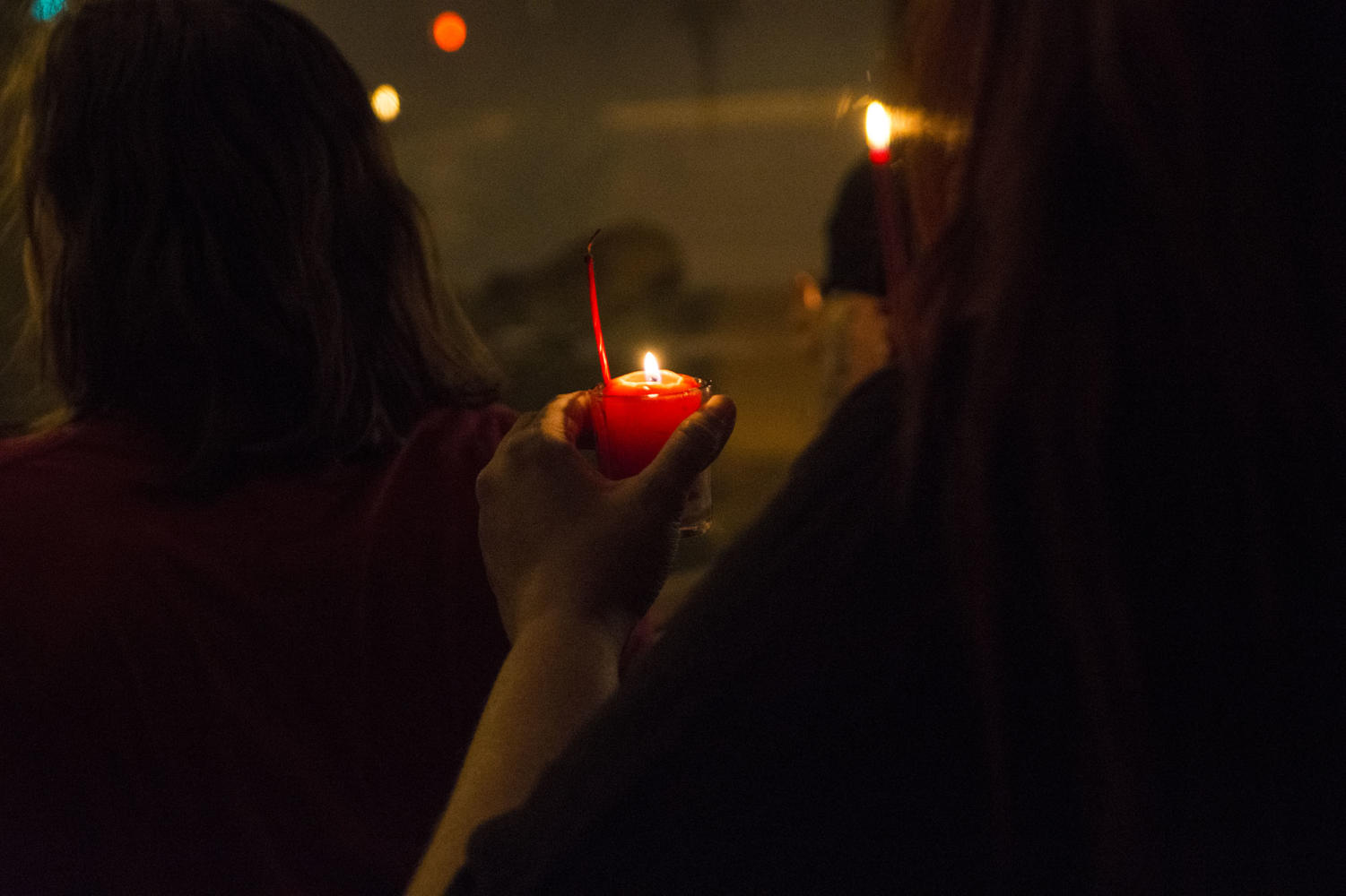 A participant in the Imbolc ritual holds a candle Saturday, Feb. 3, 2018, at The Gaia House in Carbondale. (Athena Chrysanthou | @Chrysant1Athena)