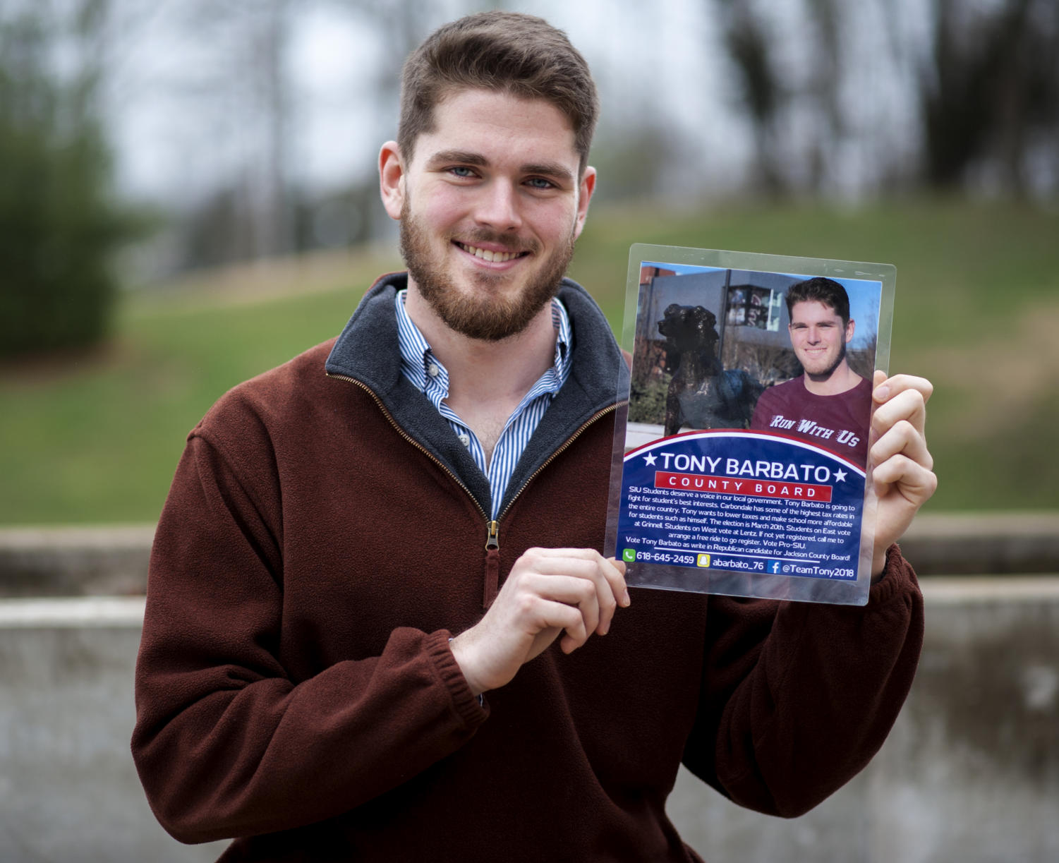 "Anthony Barbato, a junior studying management from Metropolis, poses for a portrait, Wednesday, Feb. 28, 2018, outside Rehn Hall. Barbato is a Republican write-in candidate for the Jackson County sixth district County Board. ""I have SIU students' best interest in mind. Whenever I get onto the Jackson County Board I'm going to fight to lower tuition for students, and taxes for Jackson County residents, and I want to make Jackson County a positive learning environment as well as a place where businesses can thrive. I will also drive students to vote at the courthouse for free, no matter how they want to vote,"" Barbato said. The election is March 20, 2018. (Mary Newman 