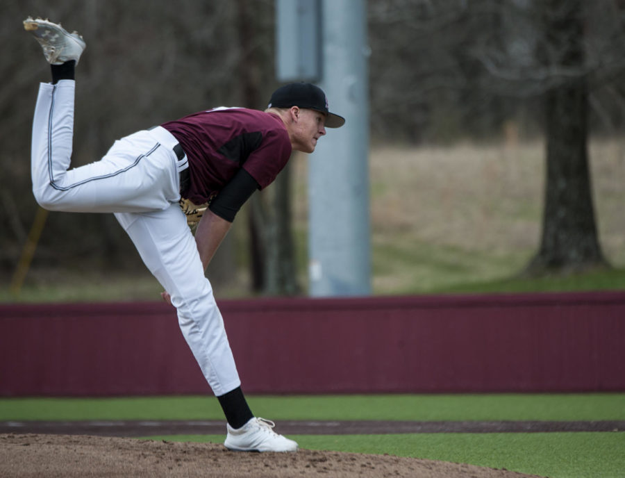 Senior Michael Baird, 31, of Parker, Colo. pitches on Friday, March 23, 2018, during the Saluki's 2-6 loss against University of California, Irvine at Itchy Jones Stadium. (Mary Newman | @MaryNewmanDE)