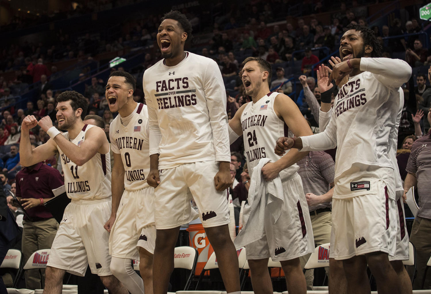 Members of the SIU men's basetball team celebrate a point Friday, March. 3, 2018, during the Salukis' 67-63 win against the Missouri State Bears at the MVC tournament in St. Louis. (Athena Chrysanthou   @Chrysant1Athena)