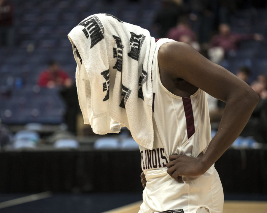 Junior guard Armon Fletcher bows his head Saturday, March. 3, 2018, during the Salukis' 76-68 loss against the Illinois State Redbirds at the Missouri Valley Conference