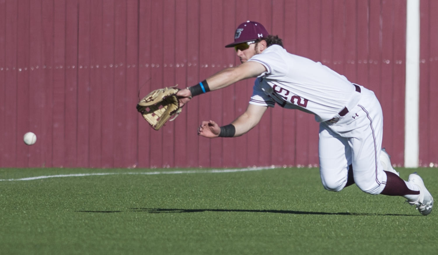 Junior left fielder Alex Lyon dives for the ball Saturday, March 3, 2018, during the Warkhawks 13-7 win against the Salukis at Itchy Jones Stadium. (Dylan Nelson | @Dylan_Nelson99)