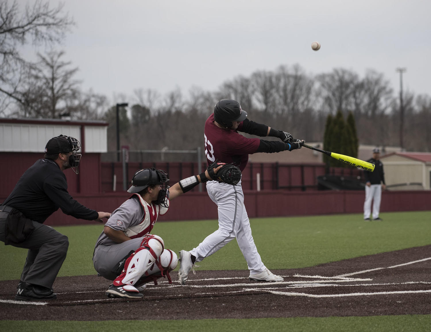 Senior infielder Hunter Anderson bats the ball Friday, March 9, 2018, during the Salukis' 4-0 win against Northern Illinois University at Itchy Jones Stadium. (Nathan Dodd | @NathanMDodd)