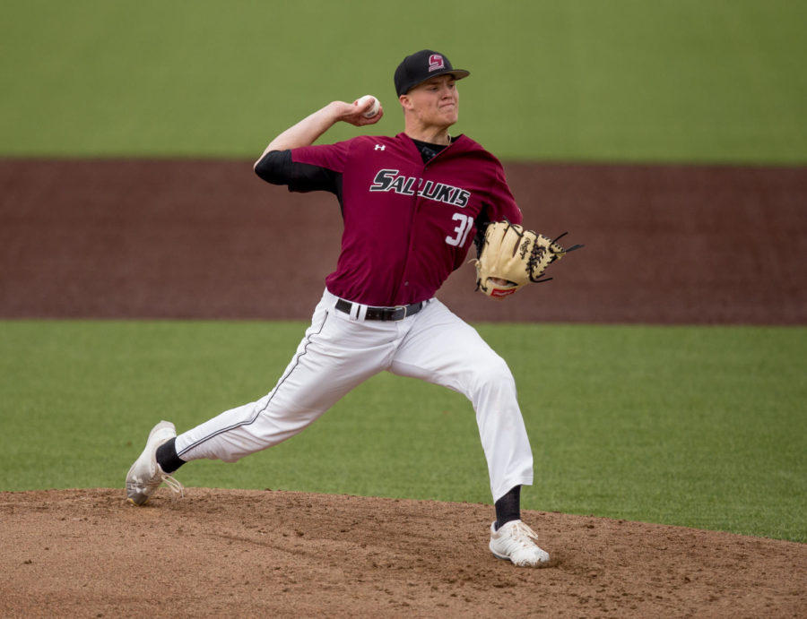 Southern Illinois senior pitcher Michael Baird (31) launches the ball Friday, March 23, 2018, during the University of California-Irvine Anteaters'  6-2 victory against the Southern Illinois Salukis at Itchy Jones Stadium. (Brian Munoz | @BrianMMunoz)