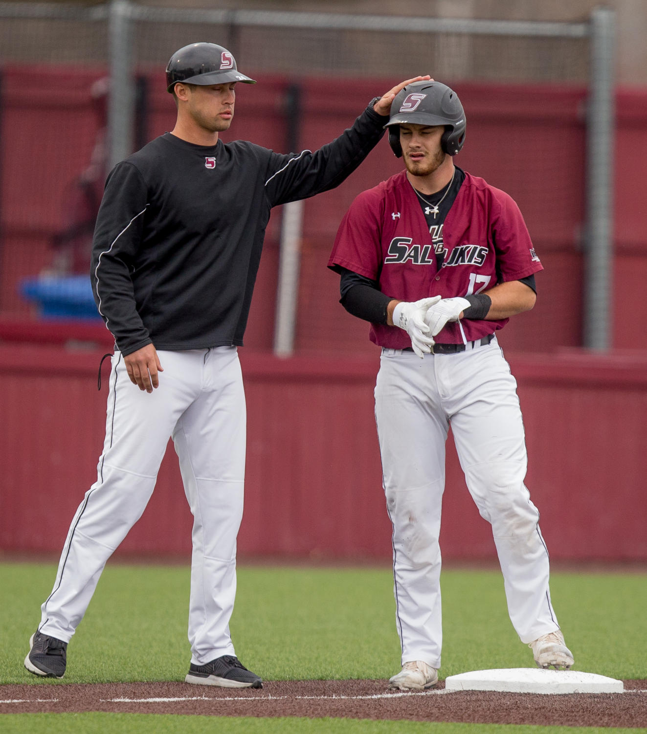 Southern+Illinois+sophomore+catcher+Austin+Ulick+%2817%29+is+congratulated+after+making+a+run+to+third+Friday%2C+March+23%2C+2018%2C+during+the+University+of+California-Irvine+Anteaters%27+6-2+victory+against+the+Southern+Illinois+Salukis+at+Itchy+Jones+Stadium.+%28Brian+Munoz+%7C+%40BrianMMunoz%29